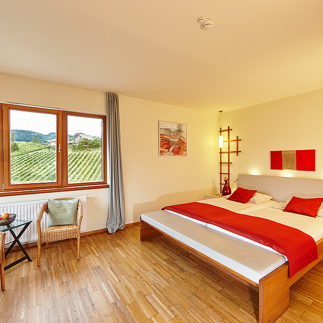 Feel good in our rooms with a view of the wine
