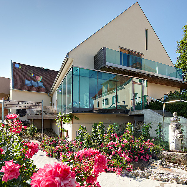 Exterior of the hotel and loving design around the house