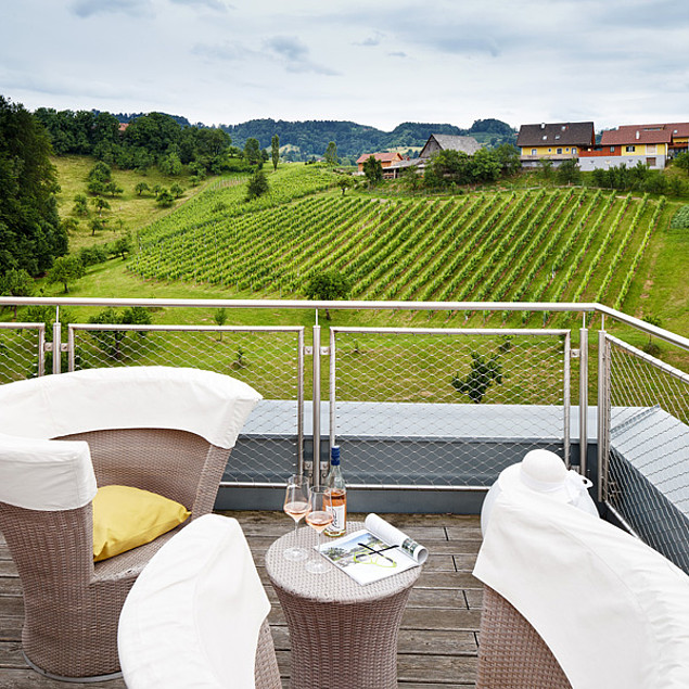 On the terrace with a glass of sparkling wine and breathtaking views of the surroundings